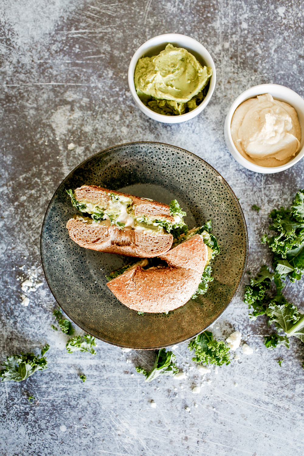 Houmous and guacamole bagel with kale