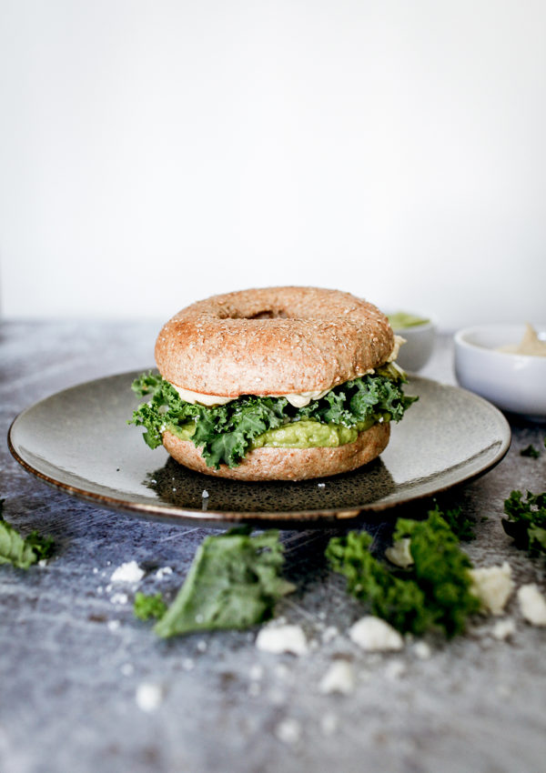 Hummus and guacamole bagel with kale