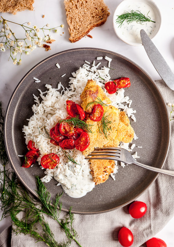 Crispy fish in oven with roasted cherry tomatoes
