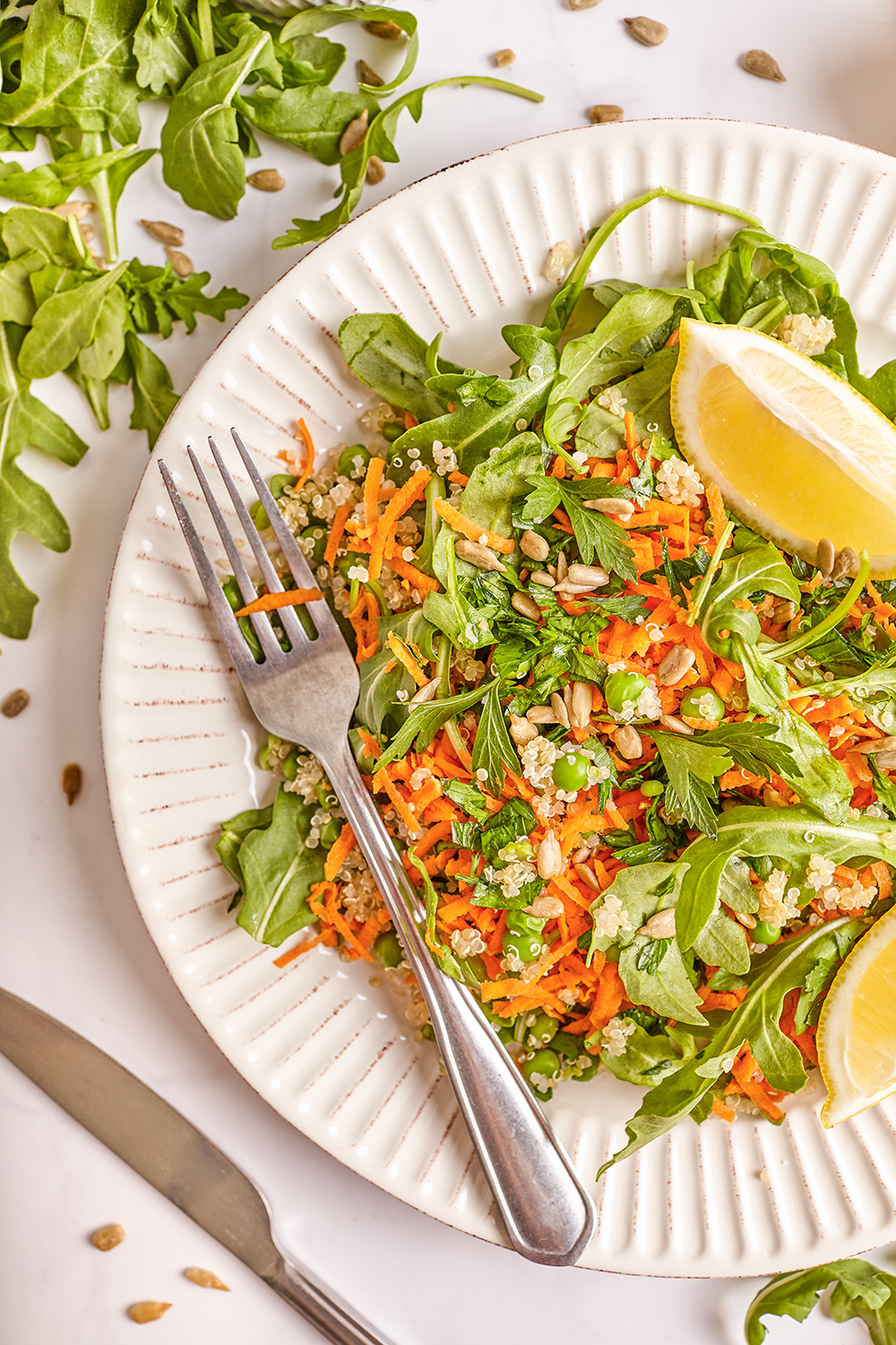 Arugula and carrot salad with quinoa
