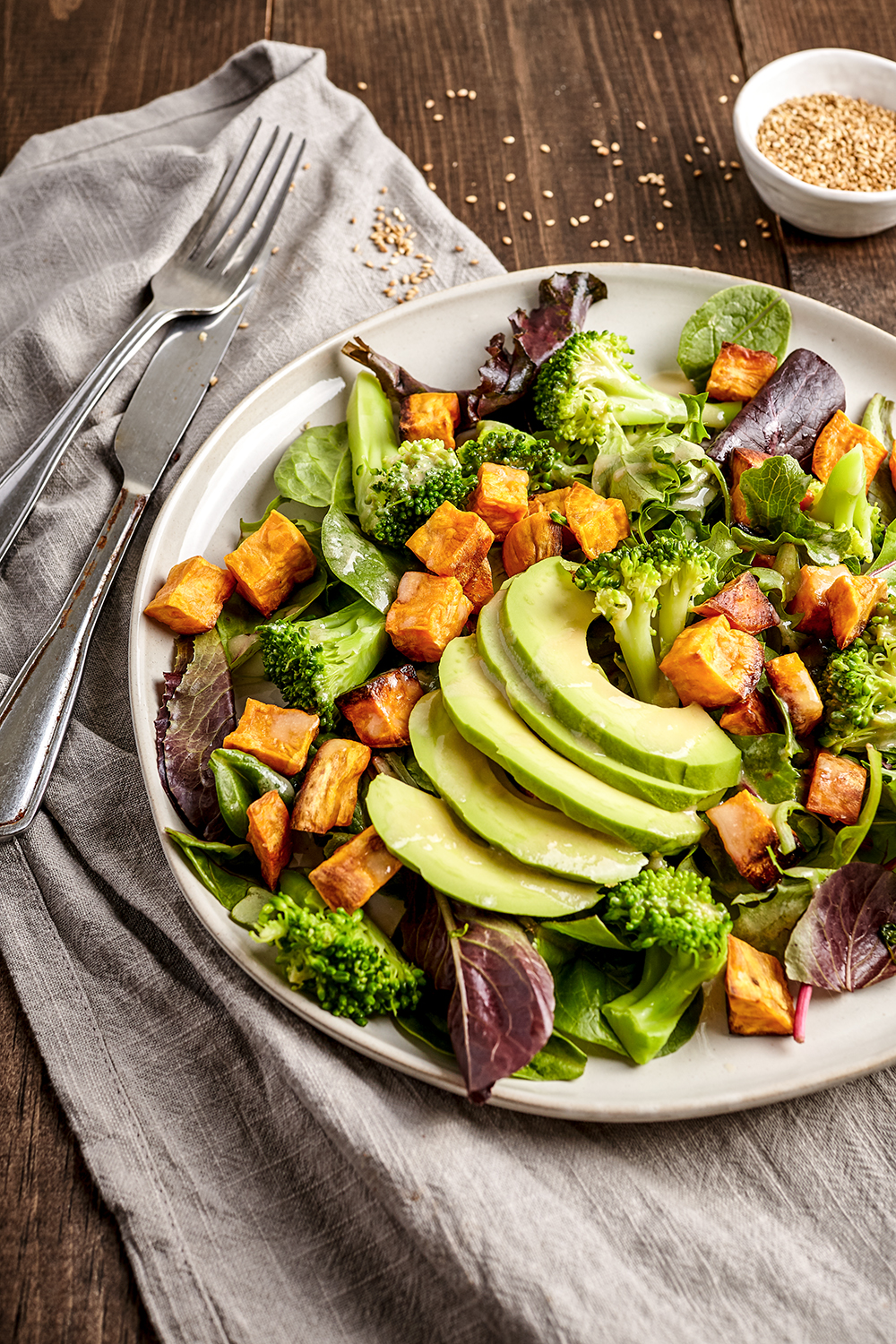 Roasted sweet potatoes and broccoli salad with honey tahini dressing