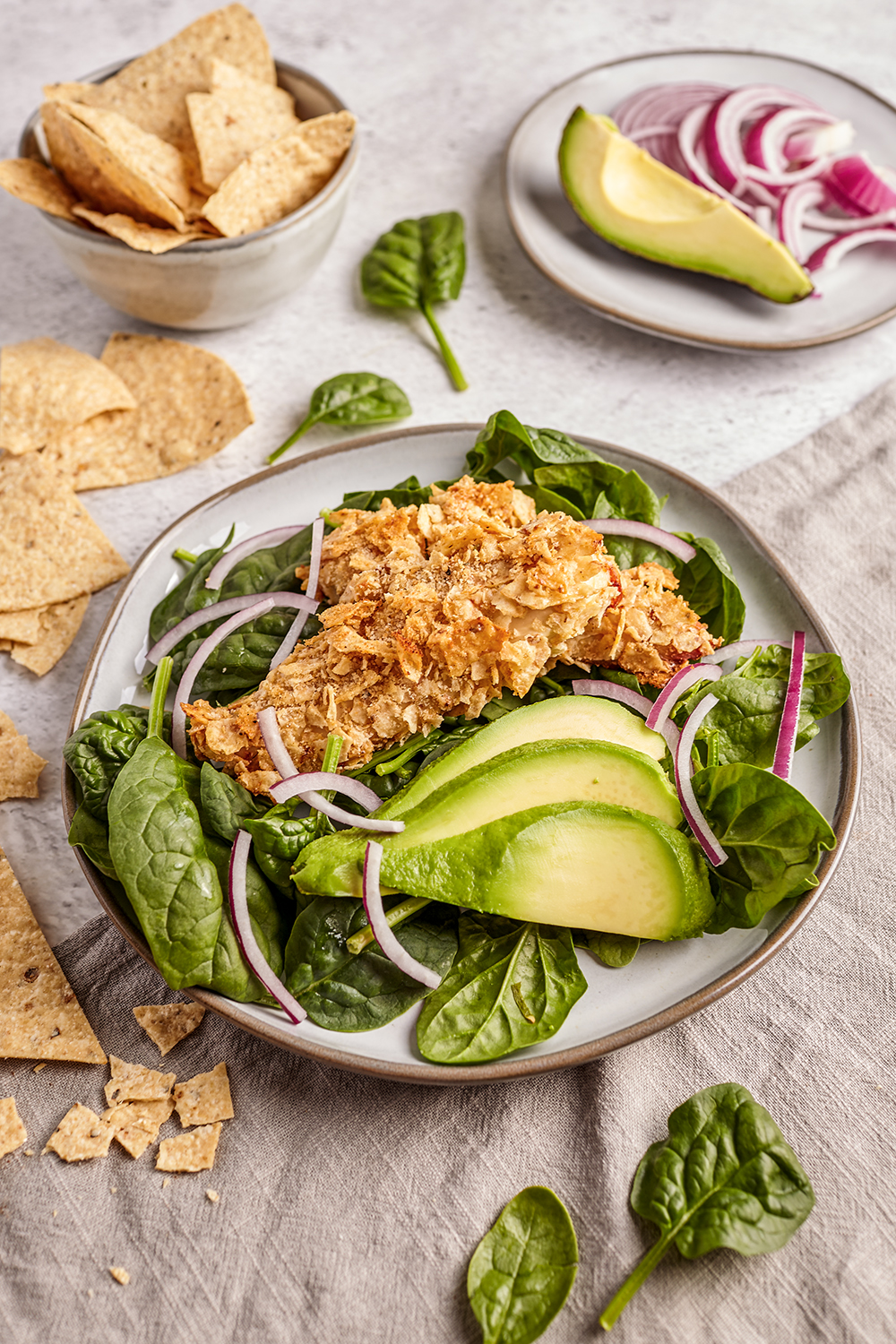 Crusted nachos chicken with avocado and spinach