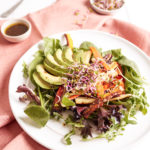 Multicolor carrot salad with avocado and sprouts