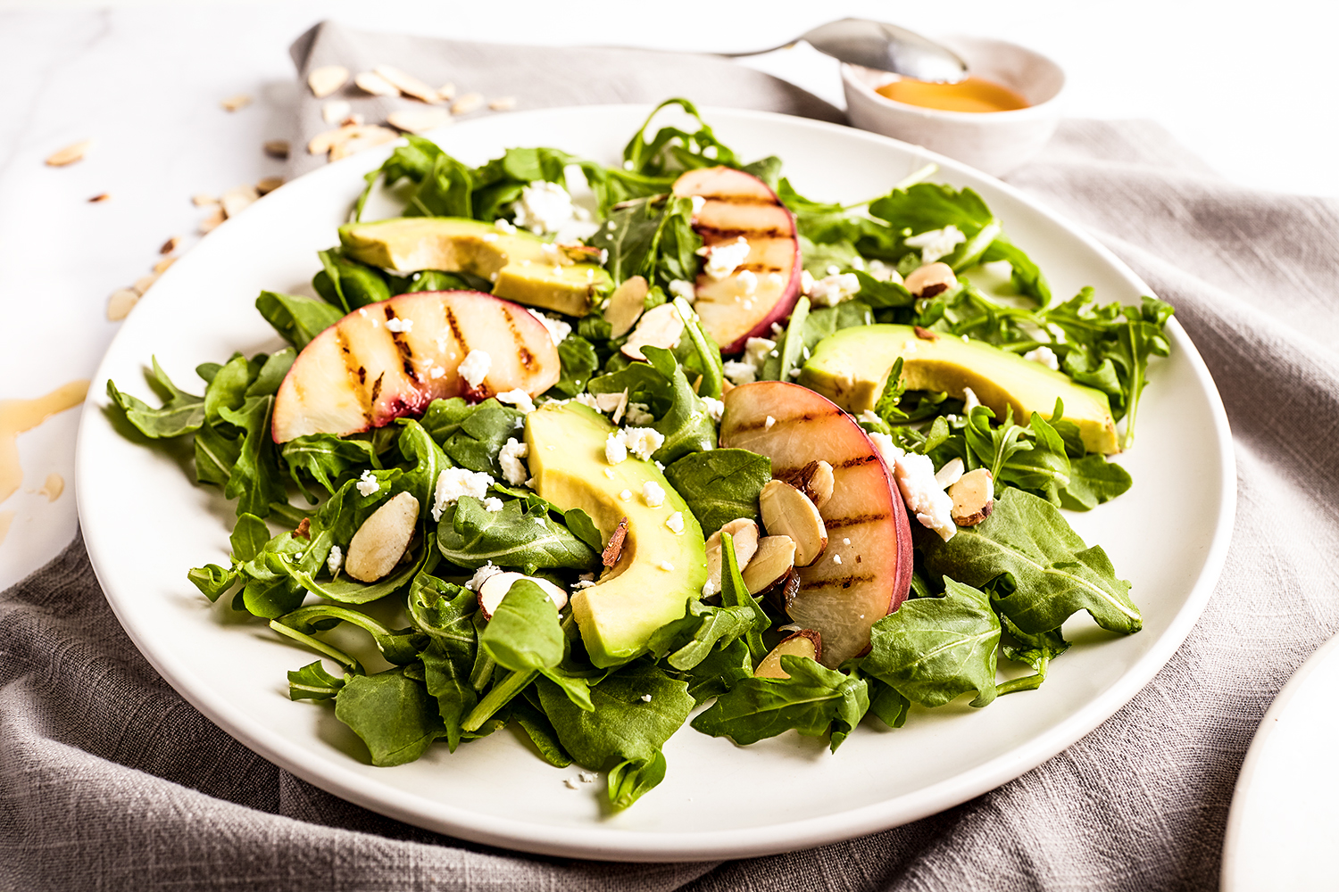 Grilled peach salad with honey dressing
