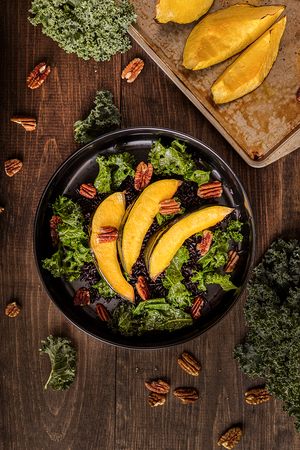 Acorn squash bowl with black rice and kale
